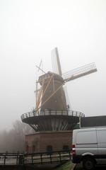 Windmill in big fog in Nieuwerkerk aan den IJssel