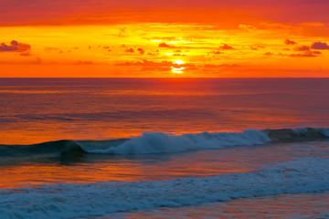 Beautiful sunrise over the quiet calm sea.