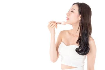 Woman holding make-up brushes isolated on white background