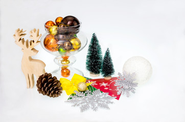 Christmas decorations with trees and orchids in glass bottles and white wooden floor.