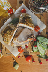 Baked meat on wooden frne with fresh vegetables and pepper/food