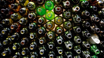 Dirty empty wine bottles close-up