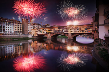 Aluminium Prints Florence celebrating New year's eve in Florence, Italy - explosive fireworks around ponte vecchio on river arno