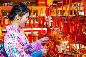 Women in traditional japanese kimonos at Fushimi Inari Shrine in Kyoto, Japan Wall mural