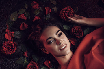 girl with roses in her black hair