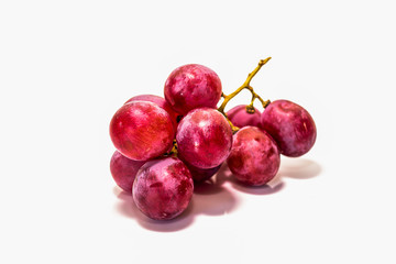 Red grapes cooked on white back ground.