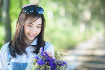 portrait of beautiful girl with flowers on green background