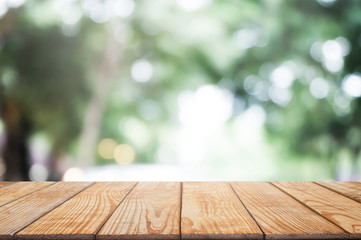 empty wood table in front of blurred montage nature in the garden background