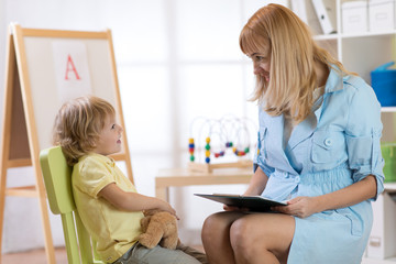 Child psychologist working with little boy