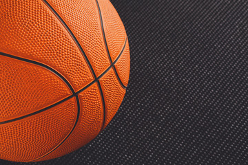 Basketball ball on black background copy space