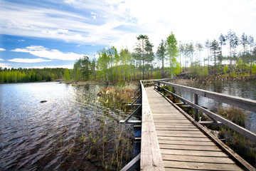 Wooden pier on beautiful lake in the national park Repovesi, Finland, South Karelia.