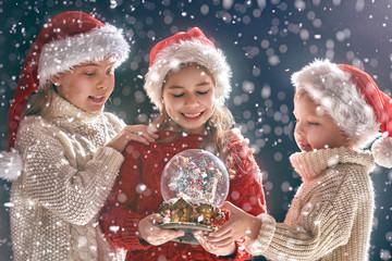 children with snow globe