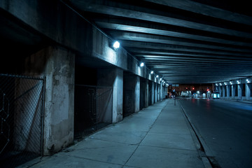 Wall Mural - Gritty dark Chicago city street with industrial train bridge viaduct tunnel at night.