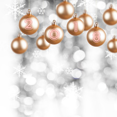golden ornaments with the new year number 2018