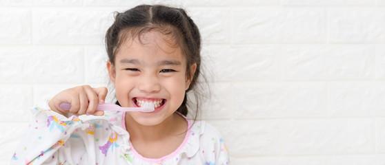 Little asian cute girl brush teeth