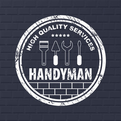 Professional handyman services logo.  Stamp handyman services on dark bricks background.  Stamp with dry rough edges. Flat design. Vector illustration EPS10.