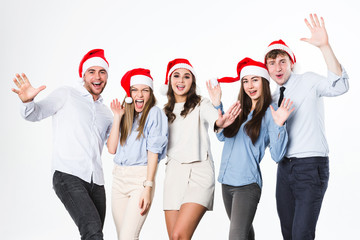 Group of young people in santa hat having fun on a white background.