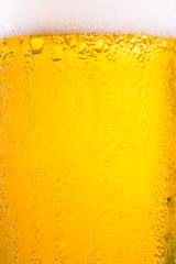Drop and foam of beer as background