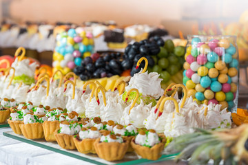 Dessert buffet with baking, sweets, fruits, close. Catering