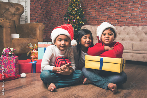 indian kids celebrating christmas cute little indian kids playing laughing and having fun with