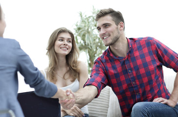 woman psychologist greets the customer before the beginning of the family session.
