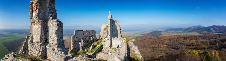 Abandoned ruins of medieval Plavecky castle in autumn Wall mural