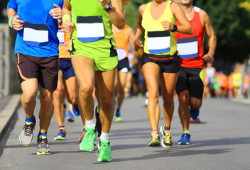 athletes run fast during the racing race in the city