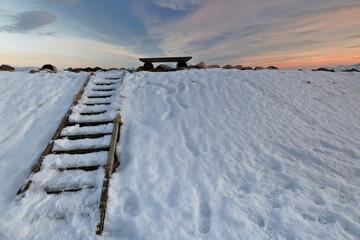 Wooden ladder to bench against sky. Lodingen fishing port-Hinnoya-Lofoten-Norway. 0664