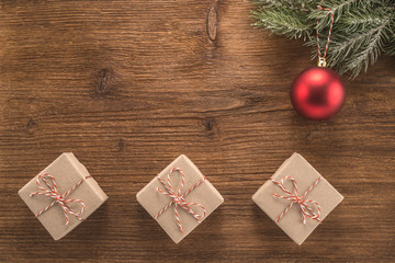 Christmas background with red ball and gift boxes