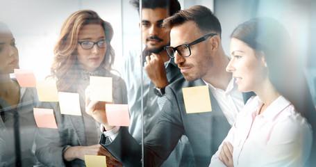 Fotobehang - Corporate teamworking colleagues in modern office