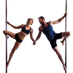 young athletic  woman and bearded man doing strength exercises on a pylon,  isolated on white background