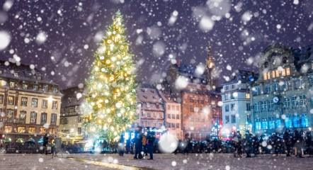 Christmas market under the snow in Strasbourg, Alsace, France