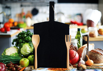 Kitchen a large black Board with vegetables and bread