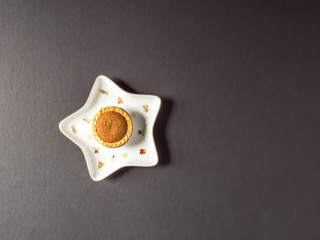 Overhead View Festive Christmas Star Shape Plate With Mince Pie Cup Cake on Dark Background