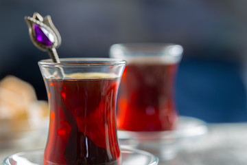 Red tea in turkish glasses on a wooden table