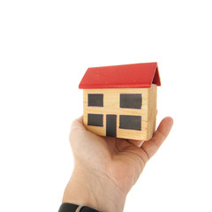 Miniature house in hand