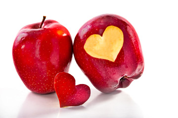 Two red apples and the cut-out heart
