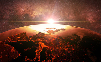 sunset over planet Earth, the city light of Europe in front of the Milky Way