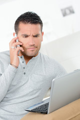 busy man with working on laptop and using mobile phone