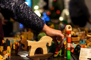 2 December, 2017, Loft Space 18/46, Saint-Petersburg. Hygge Festival. Wooden bright toy in woman hand, handmade christmas market