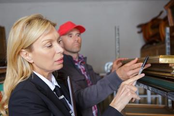 worker checking piece of art in workshop