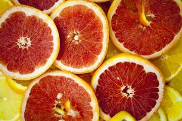 Grapefruit slices background texture.