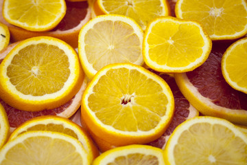 Orange grapefruit slices background texture.