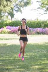 young fitness sports woman runner running on park trail