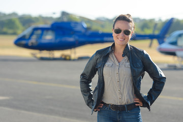 female pilot posing in the tarmac