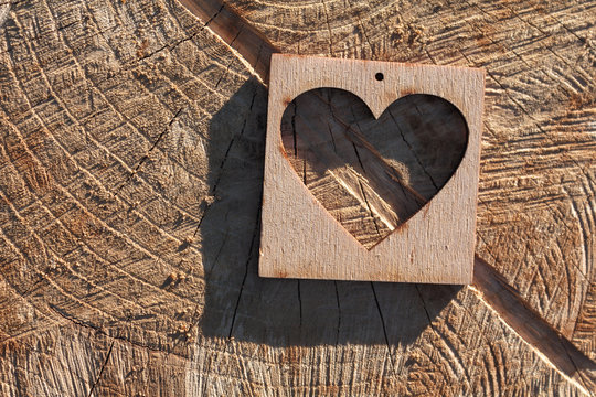 Wooden heart on an old cracked surface
