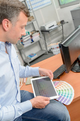 Designer holding a tablet