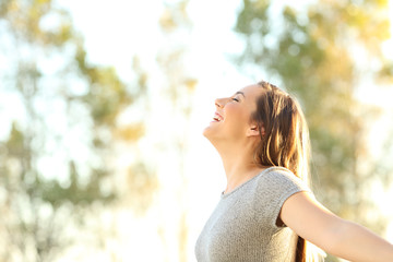 Woman breathing fresh air outdoors in summer