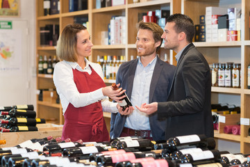 female wine merchandiser and her customers