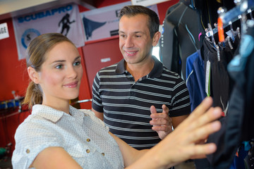 Man and woman browsing sports clothes
